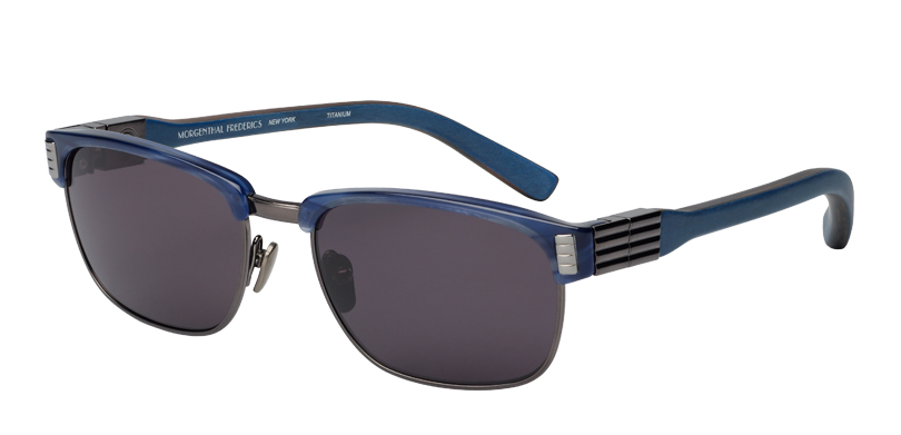 Charlie::Morgenthal Frederics Royals Collection.<br />Titanium and acetate combination, handcrafted in Japan, featuring wood temples, handcrafted in Germany.<br />Navy and gunmetal, with navy wood temples, with gray polarized lenses.